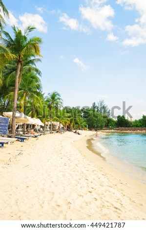Singapore, Singapore - March 1, 2016: Coastline of Siloso Beach in Sentosa island resort in Singapore. It is an artificial beach with a sand taken from Malaysia and Indonesia.