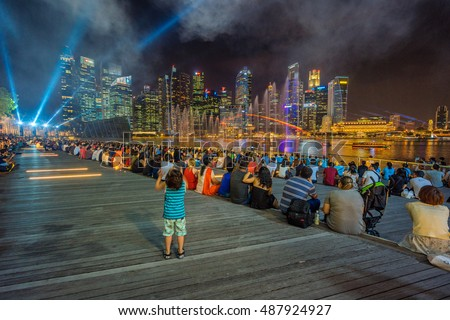 Singapore,Singapore May 7 2016 : People are watching water show in front of The Shopper of Marina Bay at downtown of Singapore