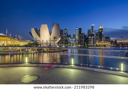 SINGAPORE, SINGAPORE - MAY 13: The skyline of Singapore lit up at night with the ArtScience Museum in the foreground. Photo taken May 13, 2014 in Singapore, Singapore. - stock photo