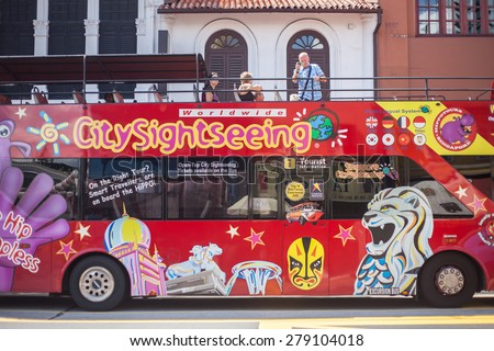 Singapore, Singapore - May 10, 2014: Tourist on the bus for travel around the city, Singapore.