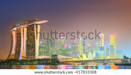 Singapore - SIRCA MAY 2015: Marina Bay skyline and view of Marina Bay Sands at twilight. The Marina Bay is a bay near Central Area in of Singapore and lies to the east of the Downtown Core. - stock photo