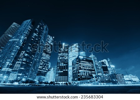 Singapore skyline at night with urban buildings - stock photo