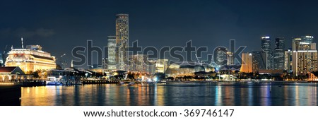 Singapore skyline at night with urban buildings