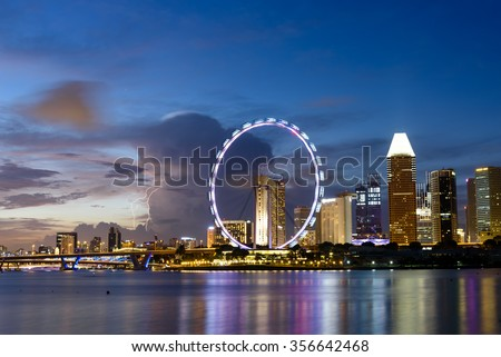 Singapore Skylines, Downtown and Financial District buildings reflection along the Singapore River at Blue Hour. Modern City Background. Urban night view. - stock photo
