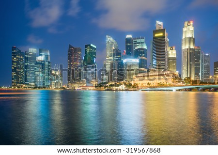 Singapore skyscapers in marina bay at night  - stock photo