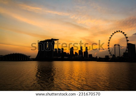 Singapore Twilight City Silhouette With Crowded Buildings - stock photo