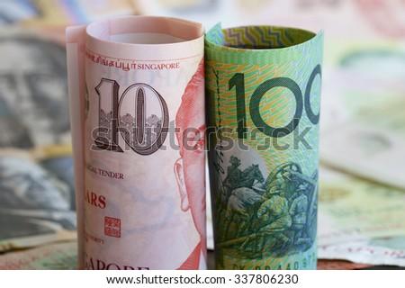 Singaporean and Australian Dollars - stock photo