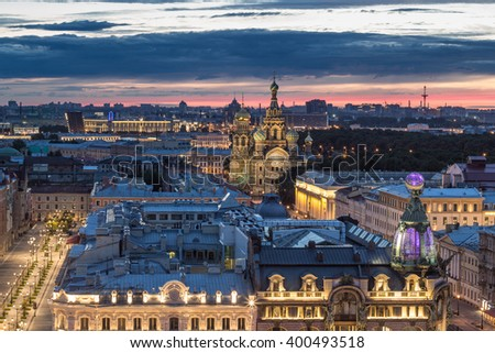 Singer building, evening Nevsky avenue, Spas-na-krovi cathedral in St. Petersburg, Russia