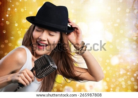 Singer. Female performer at disco with mic - stock photo