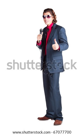 "singer is singing  in glasses with microphone; singer shows ""okey"" with his finger up on white background"