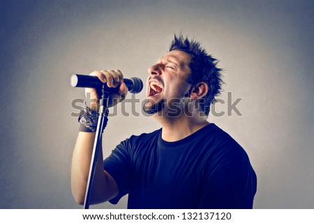 singer singing with microphone - stock photo
