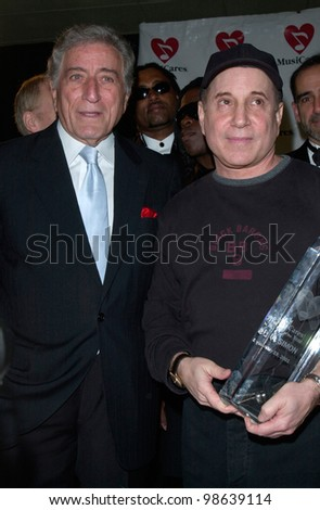 Singers TONY BENNETT (left) & PAUL SIMON at the 2001 MusiCares Person of the Year Tribute Dinner, in Los Angeles, at which Simon was honored. 19FEB2001      Paul Smith/Featureflash