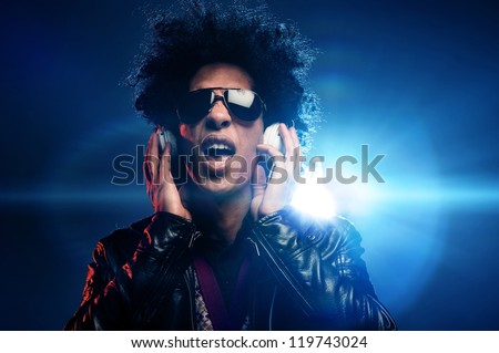 Singing dj with headphones in nightclub party scene and afro, lighting lens flare