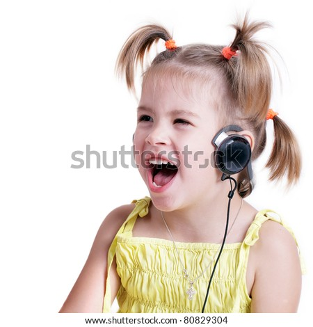 Singing Little Girl with headphones (isolated) - stock photo