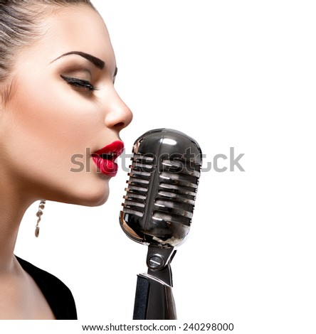 Singing Woman with Retro Microphone. Beauty Glamour Singer Girl Portrait. Isolated on White Background. Vintage Style. Karaoke Song  - stock photo