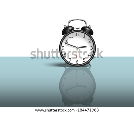 Single alarm clock on glass table white background