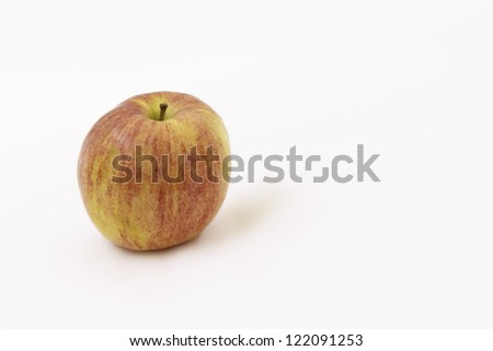 Single apple isolated against a white background