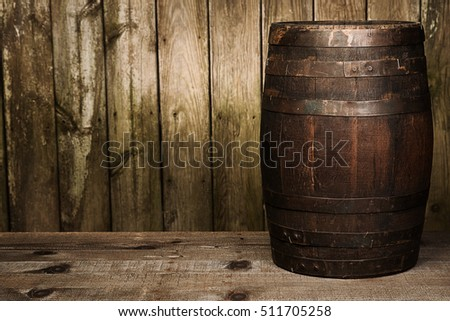 single barrel sits on a wood plank background