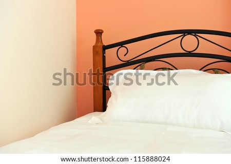 Single bed in luxurious hotel room. - stock photo