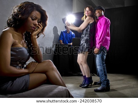 single black woman jealous of interracial couple on dancefloor - stock photo