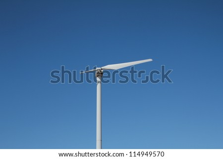 Single blade wind turbine in function on a windy day