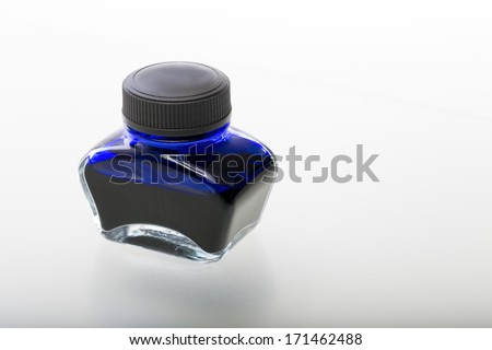 single blue glass ink pot, isolated on white.