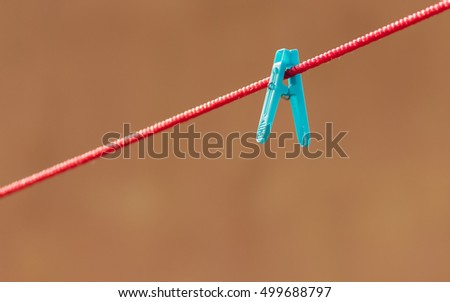 single blue hanging clip