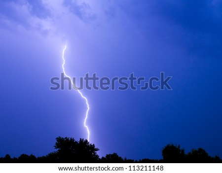 Single bolt of lightning in a thunderstorm. - stock photo