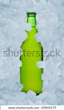 Single bottle of beer and ice - stock photo