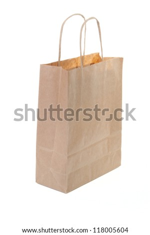Single brown paper shopping bag isolated on white background