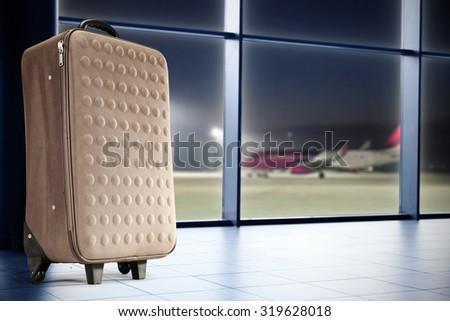 single brown suitcase  - stock photo
