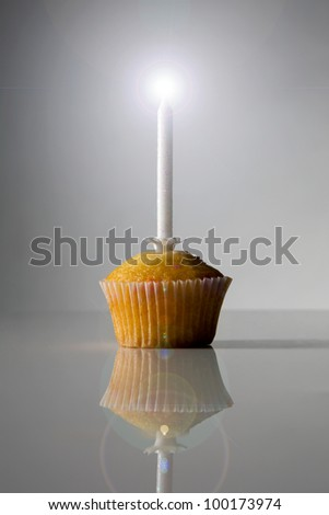 single cake with one candle burning down