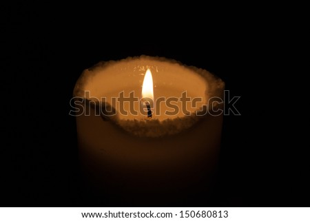 Single candle with a steady flame