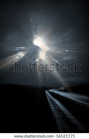 Single car travels on dark road - stock photo