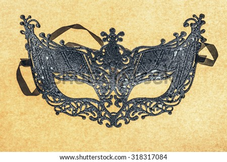 Single carnival disguise mask in close up - stock photo