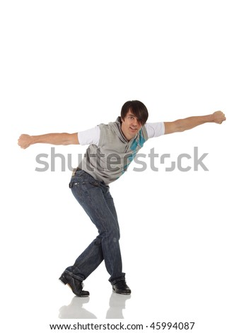 Single Caucasian male tap dancer wearing jeans showing various steps in studio with white background and reflective floor. Not isolated
