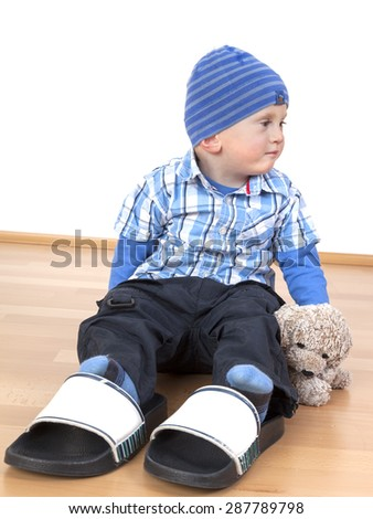 Single child without a playmate - stock photo