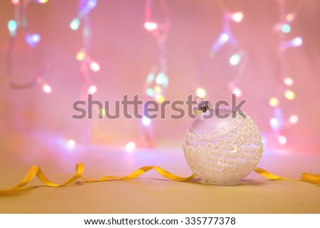 Single Christmas toy on light background decorated with garland - stock photo