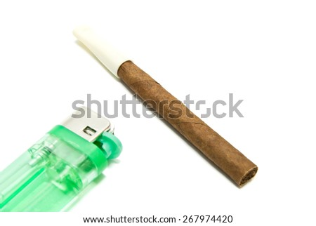 single cigarillo and plastic lighter on white background closeup - stock photo