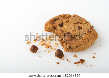 Single Cookie with a Bite and Crumbs Isolated on a White Background - stock photo