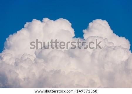 Single Cumulus cloud and blue sky - stock photo