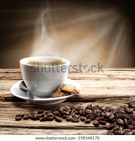 single cup of coffee and coffee beans