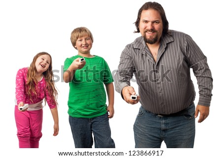 Single dad with son and daughter isolated on white playing a video game, happy family time, horizontal image easily add text