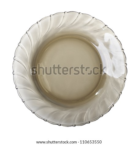 Single dark transparent plate isolated on white background - stock photo