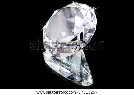 single diamond with reflection on the black background - stock photo