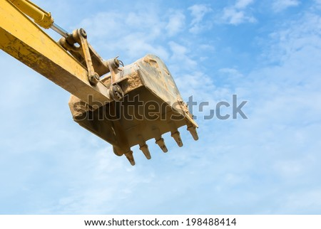 single digger shovel isolated on blue sky - stock photo