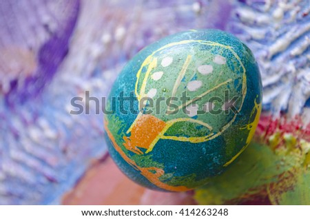 Single easter egg with beautiful color abstract picture, isolated on colored textured background. Children painting. - stock photo
