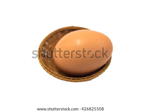 Single Egg In The Mini Wooden Basket (Isolated) - stock photo
