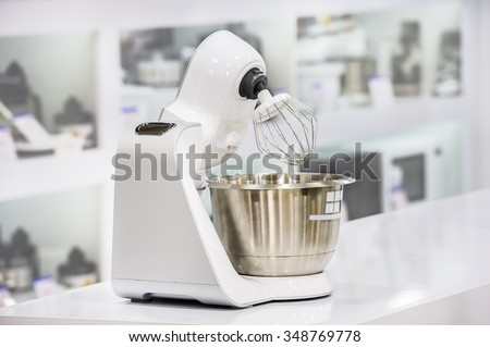 single electric food processor at retail store shelf, defocused background - stock photo