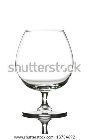 Single empty brandy glass isolated over white - stock photo